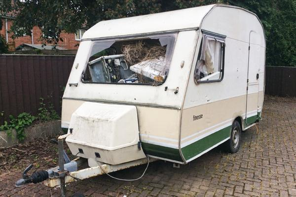 Fly tipped caravan filled with rubbish - prosecution