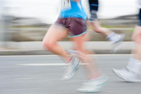 blurred runner feet and legs
