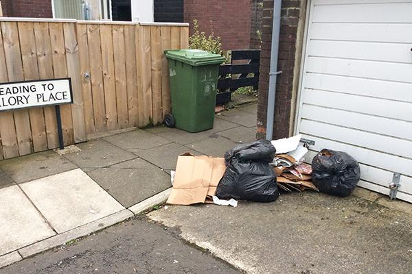 Rubbish dumped by garages