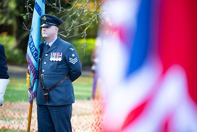 Soldier standing with flag