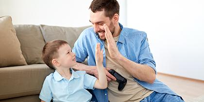 Carer and young boy happy playing