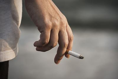 cigarette in persons hand