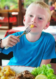 Boy enjoying school lunch