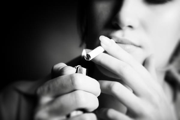 Young girl smoking, monochrome